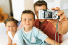 Family with digital camera